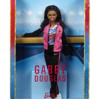 "When Gabby Douglas was just four years-old, her older sister showed her how to do a cartwheel. The little girl flipping around her house would later become the first woman of color to win the individual all-around competition for gymnastics. Her confidence, work ethic and belief in herself make her an extraordinary role model to girls. The Gabby Douglas Barbie doll celebrates the extraordinary accomplishments of this inspiring athlete and earns her role as a Barbie ""Shero"" honoree, a female hero inspiring girls by breaking boundaries and expanding possibilities for women everywhere.  She's fully poseable in her signature stars and stripes leotard, and coordinating team warm up suit. Whether she is training at the gym or dazzling the crowd during competition, Gabby has earned her spot as a true ""Shero!"""